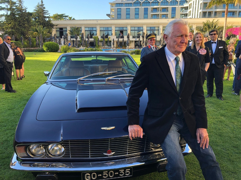 George meets the press with an Aston Martin