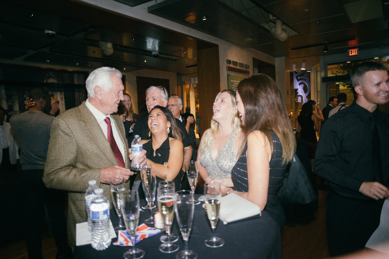 George Lazenby with Bond Girls at International Spy Museum