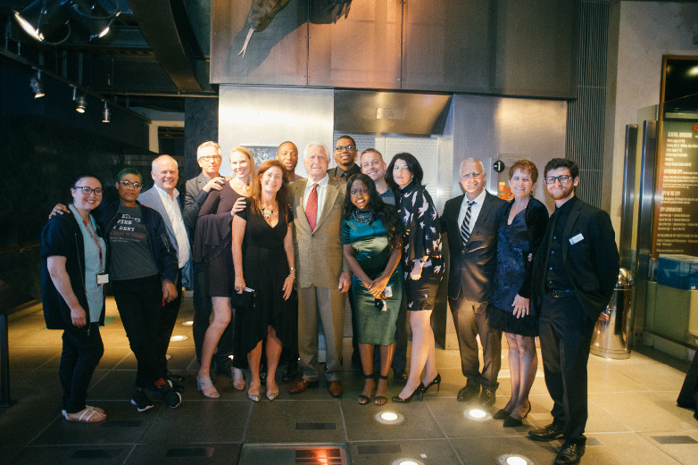 The International Spy Museum staff with George Lazenby
