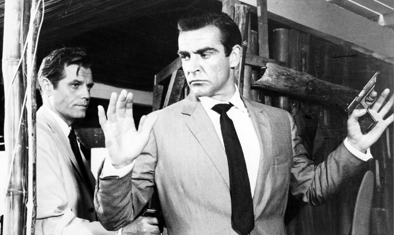Jack Lord as Felix Leiter and Sean Connery as James Bond in Dr. No