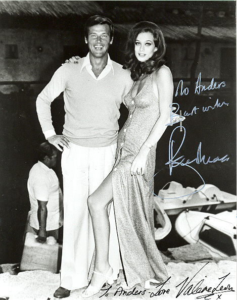 Sir Roger Moore and Valerie Leon 10x8, black and white