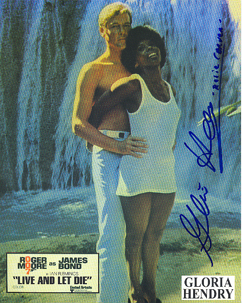 Gloria Hendry, pictured with Sir Roger Moore Signed 10x8 inch photo