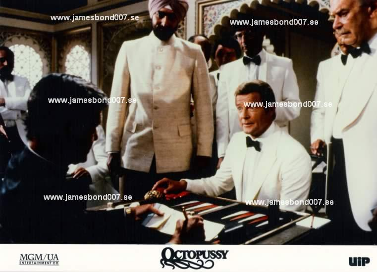 Louis Jordan, Kabir Bedi, Sir Roger Moore and extras Colour edition