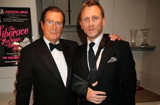 Roger Moore with Daniel Craig in London