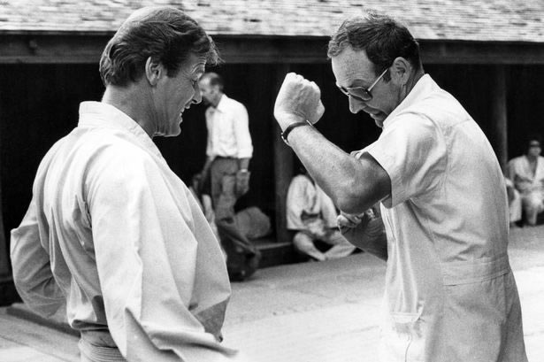 Roger Moore with Guy Hamilton on the set of The Man with the Golden Gun in Thailand