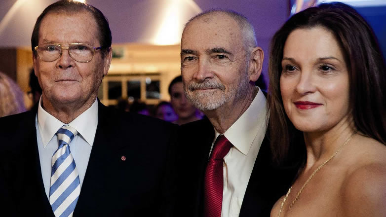 Roger Moore with Michael G. Wilson and Barbara Broccoli