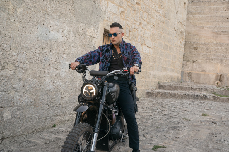 Primo on his Triumph Scrambler 1200 XE in Matera, Italy for No Time To Die